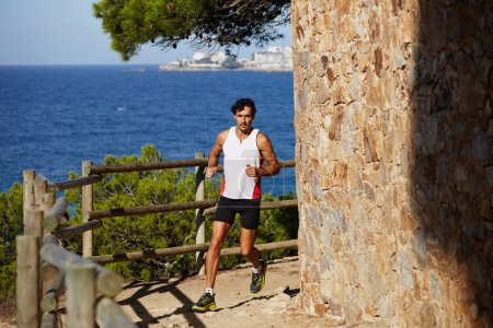 Male athlete jogging outdoors