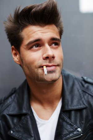 Man with cigarette in his mouth