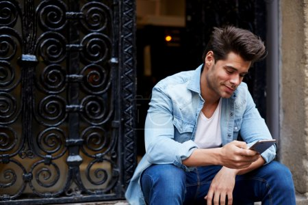 Man sending a text message
