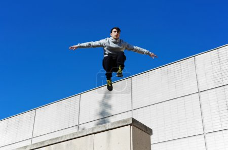 Male parkour free runner jumping