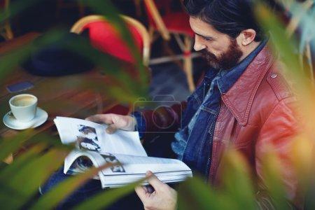 Hipster man read magazine