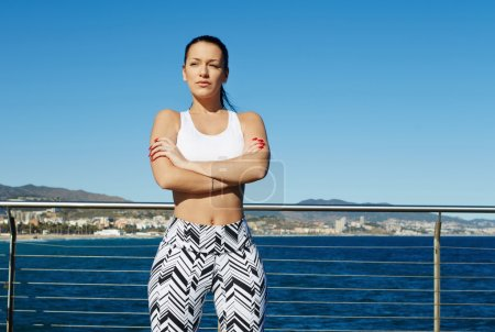 sporty woman with crossed hands