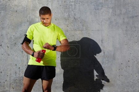 man holding a water bottle