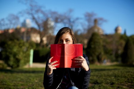 young woman with red book