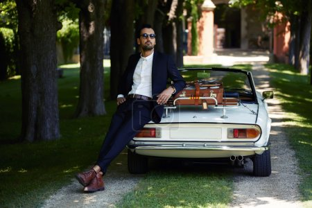 Businessman near his luxury car