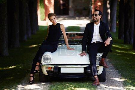 Romantic and fashionable couple posing on luxury c...