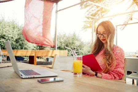 female freelancer reading notebook