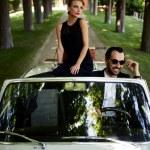 Happy couple enjoying a ride on their luxury conve...