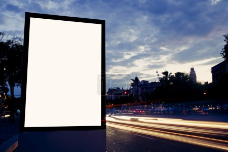 Photo pour Illuminated blank billboard with copy space for your text message or content, public information board in night city with beautiful dusk on background, advertising mock up banner in metropolitan city - image libre de droit