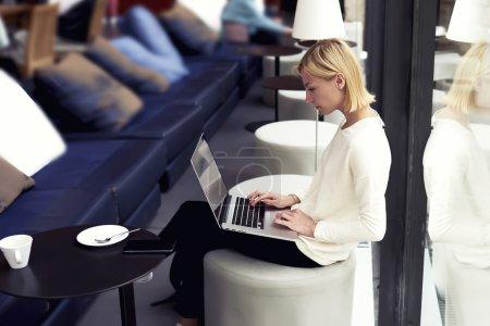 Female freelancer working on laptop computer