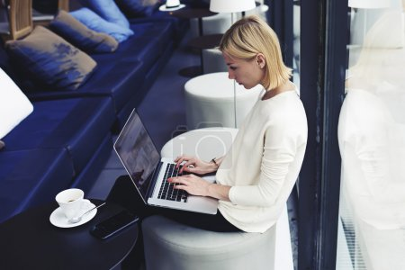 Female freelancer working on laptop computer