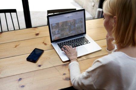 female freelancer sitting front laptop computer