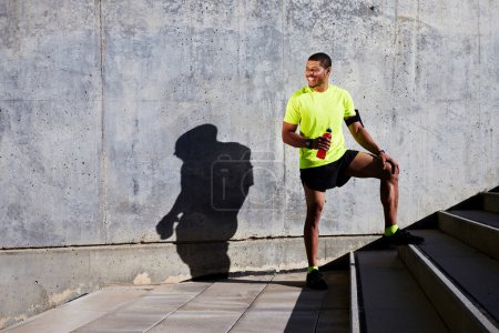 man jogger refreshing with energy drink