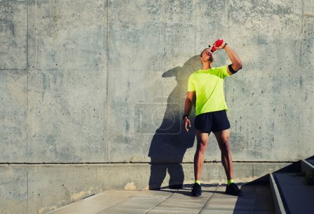 man runner refreshing with energy drink
