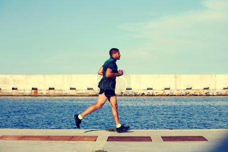 muscular runner at evening jog