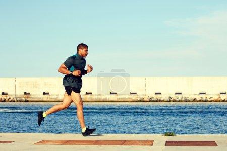 runner man working out near sea