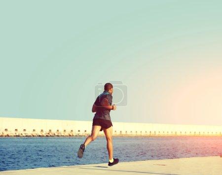 sportsman at evening jog training