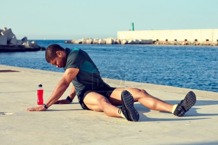Male runner doing stretching exercise