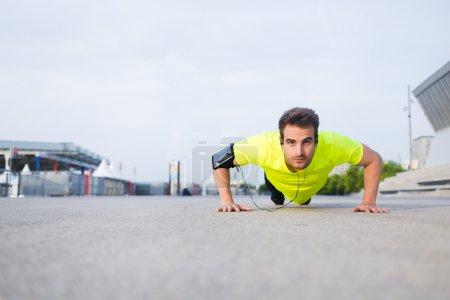 Sporsman  in bright sportswear doing push-ups