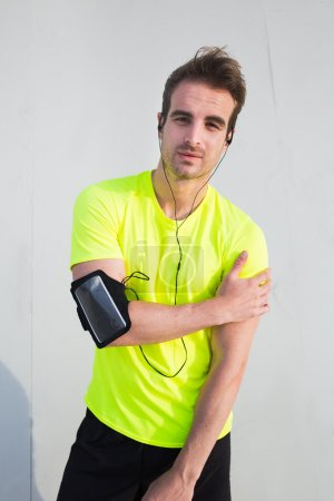 Male athlete listening to music