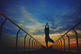 Silhouette of a woman engage yoga