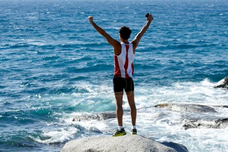 Sportsman standing on the rock
