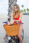 Seductive woman sitting on retro bike