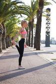 Caucasian female exercising outdoors
