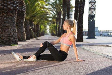 Sportswoman doing physical exercise
