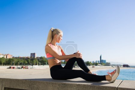 woman enjoys resting after workout outdoors