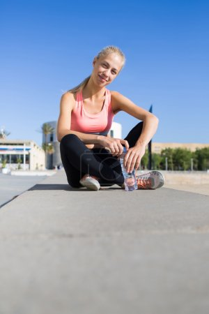 woman taking break after physical exercise