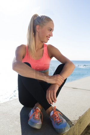 Woman jogger resting after fitness training