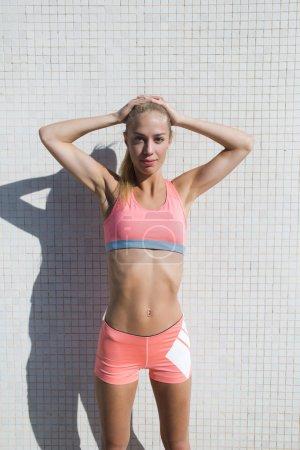 Fitness woman posing in urban setting