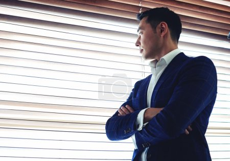 Businessman standing near office window