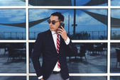 Asian businessman speaking on mobile phone