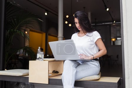 Hipster girl working on her net-book