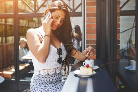 Charming woman talking on cell phone