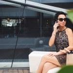 Portrait of luxury woman having mobile phone conve...
