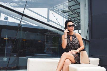 Elegant businesswoman talking on mobile phone