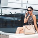 Portrait of successful businesswoman dressed in el...