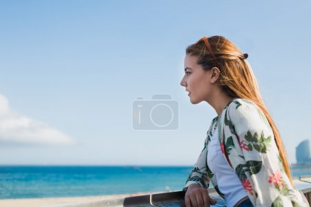 Charming young woman enjoy the sea