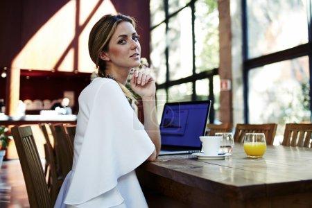 Elegant woman working on her net-book