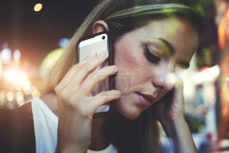 Pretty woman talking on mobile phone