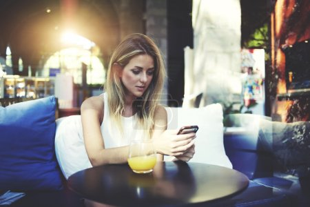 Attractive woman using mobile phone