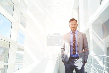 Smiling businessman posing in luxury suit