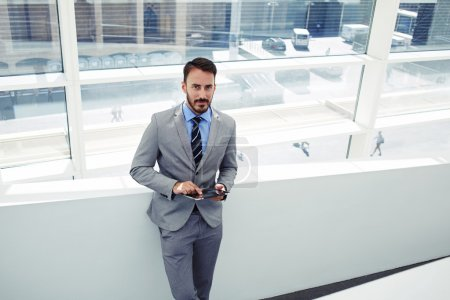 Businessman working on touch pad in office