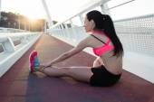 Fitness woman runner stretching legs muscles