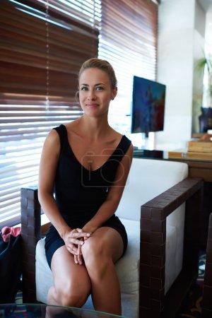 Happy businesswoman posing in modern office