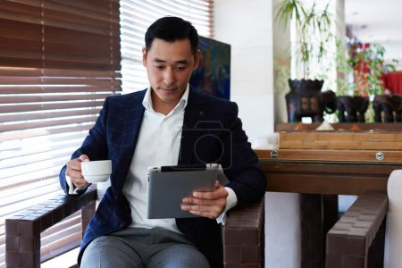 Asian businessman using touch pad