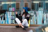 Funky female using smart phone